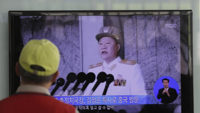 "A South Korean man watches a TV news reporting about North Korean leader Kim Jong Un's special envoy Choe Ryong Hae, at a Seoul Train Station in Seoul, South Korea, Wednesday, May 22, 2013. The ""special envoy"" for North Korean leader Kim Jong Un left Pyongyang on Wednesday for China, the North's only major political and economic benefactor. State media released few details, but the trip comes at a rocky time in ties between the allies. (AP Photo/Lee Jin-man)"