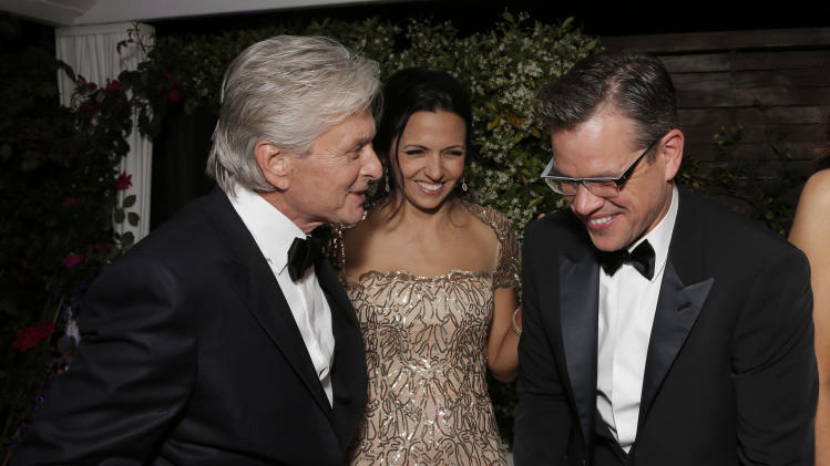 "AP10ThingsToSee - Actors Michael Douglas, Luciana Barroso and Matt Damon laugh at a party for the movie ""Behind the Candelabra"" at the 66th international film festival, in Cannes, France on Tuesday, May 21, 2013. (Photo by Todd Williamson/Invision/AP)"