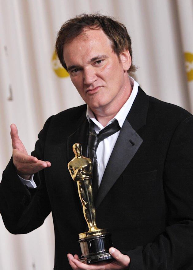 "Quentin Tarantino poses with his award for best original screenplay for ""Django Unchained"" during the Oscars at the Dolby Theatre on Sunday Feb. 24, 2013, in Los Angeles. (Photo by John Shearer/Invisi"
