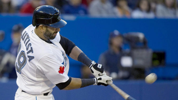 Toronto Blue Jays right fielder Jose Bautista hits a single against the Detroit Tigers during the third inning of a baseball game Monday, May 9, 2011, in Toronto. (AP Photo/The Canadian Press, Nathan Denette)