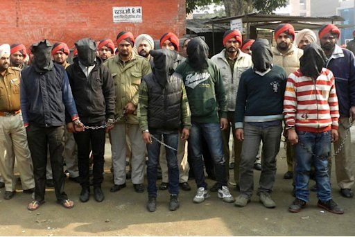 Indian police escort the six men accused of a gang rape in Punjab to a courthouse in Gurdaspur on Januray 13, 2013
