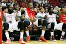 James Harden (L), Dwight Howard (C) and Patrick Beverley of the Houston Rockets wait in the bench area during a game on December 22, 2014 in Houston, Texas