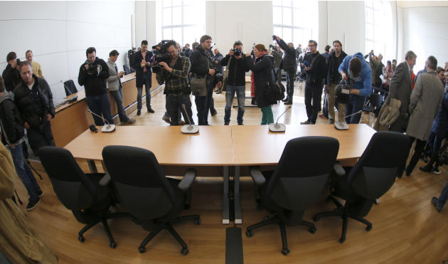 In this March 7, 2014 file picture journalists take pictures of a courtroom at the palace of justice in Munich, Germany, Bayern Munich president Uli Hoeness goes on trial in this courtroom Monday Marc