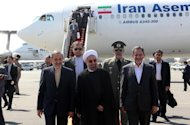 Iranian president Hassan Rouhani (C), Ali Akbar Velayati (L) advisor to the Islamic republic's supreme leader Ayatollah Ali Khamenei and Eshaq Jahangiri (R) the First Vice President arrive at Tehran's Mehrabad Airport, on September 28, 2013