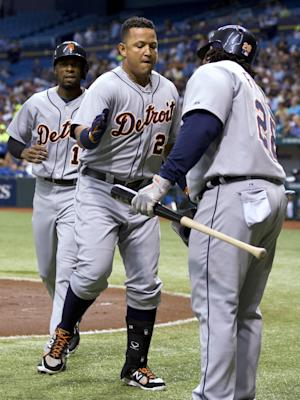 Detroit Tigers' Miguel Cabrera, center, and Austin Jackson, left, celebrates with on-deck batter Prince Fielder after Cabrera hit a first-inning, two-run home run off Tampa Bay Rays starting pitcher Alex Colome during a baseball game, Friday, June 28, 2013, in St. Petersburg, Fla. (AP Photo/Chris O'Meara)
