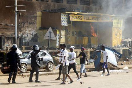 Pre-election clash in Guinea capital kills two, wounds 33