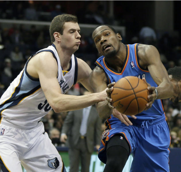 Oklahoma City Thunder's Kevin Durant, right, drives past Memphis Grizzlies' Jon Leuer in the first half of an NBA basketball game in Memphis, Tenn., Wednesday, Dec. 11, 2013