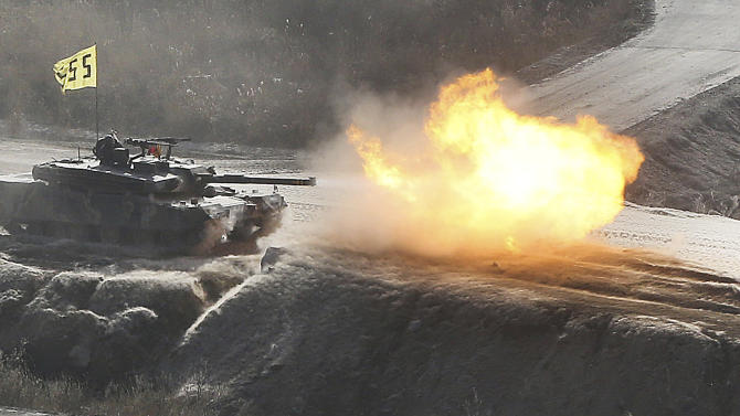 A South Korean army K1 tank fires live rounds during an exercise at Seungjin Fire Training Field in mountainous Pocheon, South Korea, near the border with North Korea, Wednesday, March 27, 2013. North Korea said Wednesday that it had cut off a key military hotline with South Korea that allows cross border travel to a jointly run industrial complex in the North, a move that ratchets up already high tension and possibly jeopardizes the last major symbol of inter-Korean cooperation.(AP Photo/Yonhap, Lim Byung-shick)  KOREA OUT