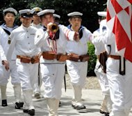 War veterans and others wearing uniforms of the Imperial Navy march at the Yasukuni shrine to honour the dead on the 67th anniversary of Japan&#39;s surrender from World War II in Tokyo on August 15, 2012