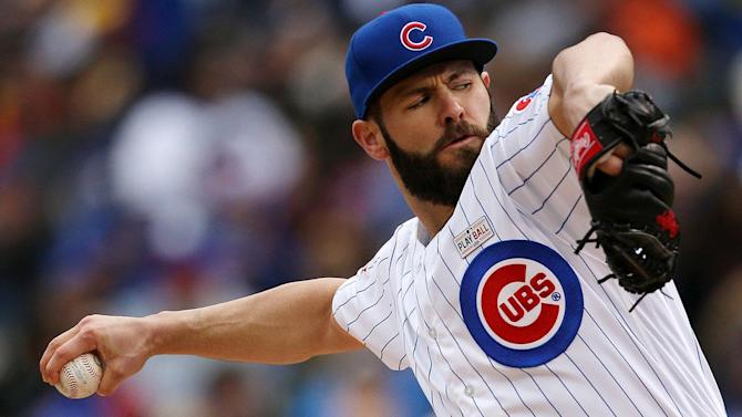 Chicago Cubs starting pitcher Jake Arrieta receives a standing ovation after pitching out of a bases-loaded jam with a strikeout of Los Angeles Dodgers pinch-hitter Justin Turner during the seventh inning of a baseball game Tuesday, May 31, 2016, in Chicago. (AP Photo/Charles Rex Arbogast)