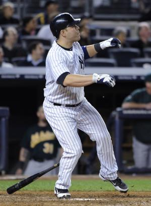 New York Yankees' Russell Martin watches his solo home run off Oakland Athletics relief pitcher Sean Doolittle in the 10th inning that gave the Yankees a 2-1 win in a baseball game Friday, Sept. 21, 2012, at Yankee Stadium in New York. (AP Photo/Kathy Kmonicek)