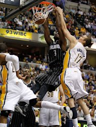 INDIANAPOLIS, IN - APRIL 28: Earl Clark #3 of the Orlando Magic gets in for a dunk next to Louis Amundson #17 of the Indiana Pacers in Game One of the Eastern Conference Quarterfinals during the 2012 NBA Playoffs on April 28, 2012 at Bankers Life Fieldhouse in Indianapolis, Indiana. Orlando won the game 81-77 to take a 1-0 series lead. (Photo by Gregory Shamus/Getty Images)