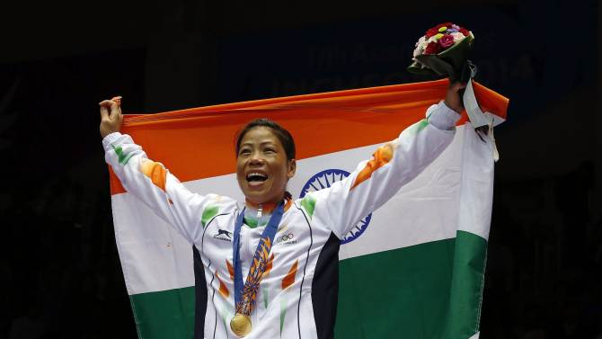 India's gold medallist Chungneijang Mery Kom Hmangte reacts during the medal ceremony for the women's fly (48-51kg) boxing competition at the Seonhak Gymnasium during the 17th Asian Games in Incheon