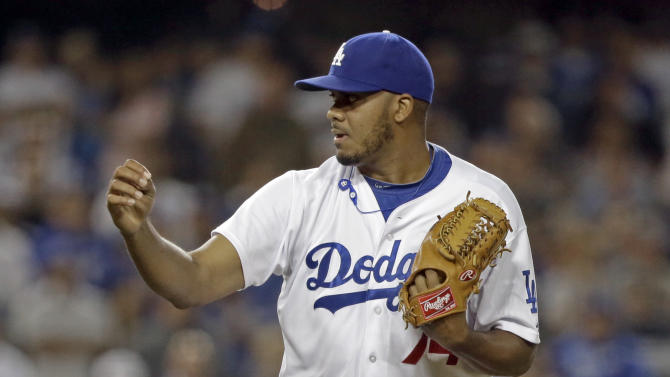 Los Angeles Dodgers closer Kenley Jansen fist pumps as he gets the final out against the Washington Nationals in a baseball game in Los Angeles Tuesday, May 14, 2013. Starter Clayton Kershaw recorded 11 strikeouts and Jansen got the save as the Dodgers won, 2-0. (AP Photo/Reed Saxon)