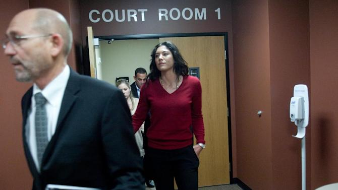 Soccer star Hope Solo leaves a courtroom with her lawyer Peter Offenbecher, left, after a bail hearing for former Seattle Seahawks player Jerramy Stevens in Kirkland, Wash. on Tuesday, Nov. 13, 2012. Stevens, a former Seahawks tight end, and Solo had planned to get married Tuesday, but the football player wound up in court after police arrested him on suspicion of assaulting Solo, according to police and court records. The judge released Stevens saying there was no evidence connecting Stevens to any assault, according to news reports. (AP Photo/seattlepi.com, Joshua Trujillo)