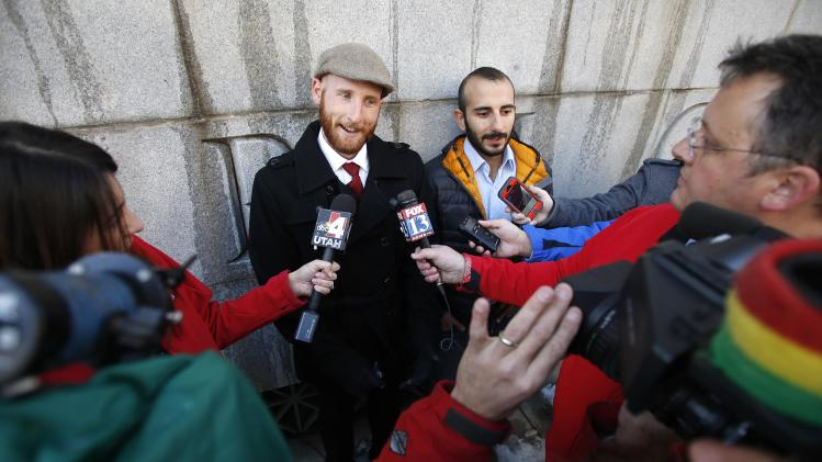 Kitchen and his partner Sbeity talk to the media outside the Frank E. Moss federal courthouse in Salt Lake City