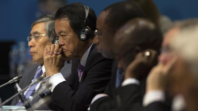 Japan's Finance Minister Aso sits next to Japan's central bank governor Kuroda as he listens to speeches during start of G20 Finance Ministers and Central Bank Governors Meeting in Cairns