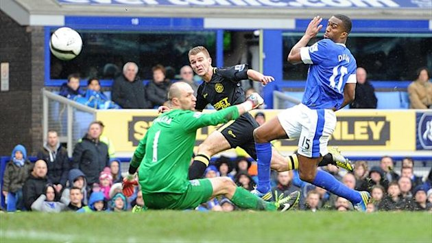 Callum McManaman, centre, scores Wigan's second goal of the FA Cup clash against Everton