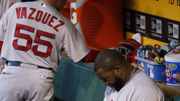 Boston Red Sox's David Ortiz sits in the dugout before taking the field for a baseball game against the Pittsburgh Pirates in Pittsburgh Thursday, Sept. 18, 2014. (AP Photo/Gene J. Puskar)