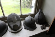 A collection of helmets and a fencing mask is seen during a preview tour of the home and studio of artist Andrew Wyeth Monday, April 23, 2012 in Chadd's Ford, Pa. The studio will be open for tours in the summer of 2012 by the Brandywine River Museum. (AP Photo/Alex Brandon)