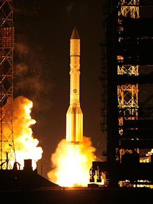 In this photo taken on Friday, Nov. 25, 2011 a Russian Proton booster rocket blasts off from the Russian-leased Baikonur cosmodrome in Kazakhstan. A similar rocket failed after its launch on Aug. 6, stranding two communications satellites.  (AP Photo)