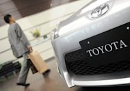 A Toyota Motor's vehicle is seen at a showroom in Tokyo. Two years after eclipsing Japan as the world's second-largest economy, China on Monday stole the number-two spot on the Fortune 500 list of the biggest global companies from its Asian rival