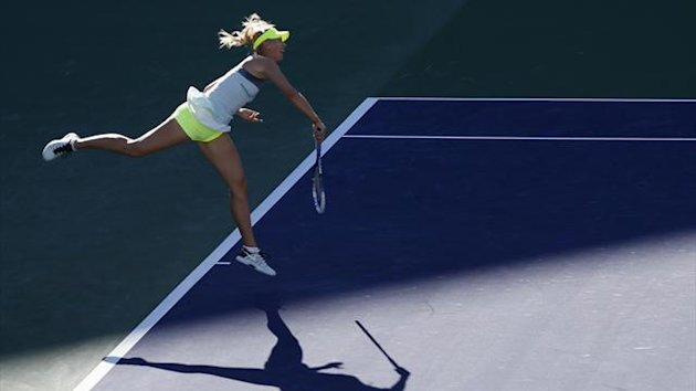 Maria Sharapova of Russia serves against Carla Suarez Navarro of Spain during their match in Indian Wells