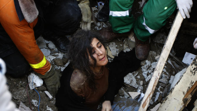 A member of the Abdel Aal family is rescued after his family house collapsed during an Israeli forces strike in the Tufah neighbourhood, Gaza City, Sunday, Nov. 18, 2012. The Israeli military widened its range of targets in the Gaza Strip on Sunday to include the media operations of the Palestinian territory's Hamas rulers, sending its aircraft to attack two buildings used by both Hamas and foreign media outlets. (AP Photo/Majed Hamdan)