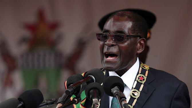 Zimbabwe President Robert Mugabe gives an address during celebrations for the country's 34th independence anniversary on April 18, 2014 in Harare