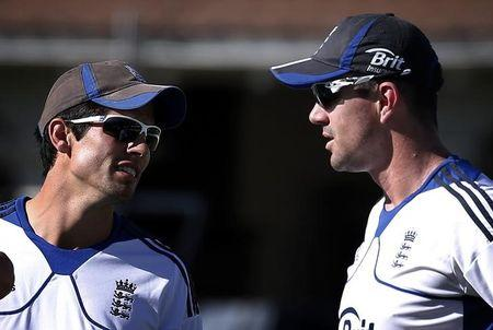England cricket team captain Cook talks with Pietersen during a team training session in Wellington