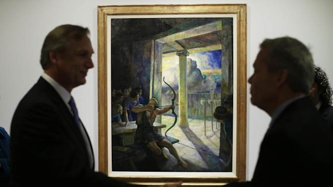 "Philadelphia Museum of Art's Timothy Rub, left, and GlaxoSmithKline's Bob Carr shake hands after viewing the N.C. Wyeth painting  ""The Trial of the Bow"" being hung at the museum, March 5, 2013, in Philadelphia. Pharmaceutical company GlaxoSmithKline donated the painting to the museum. (AP Photo/Matt Rourke)"