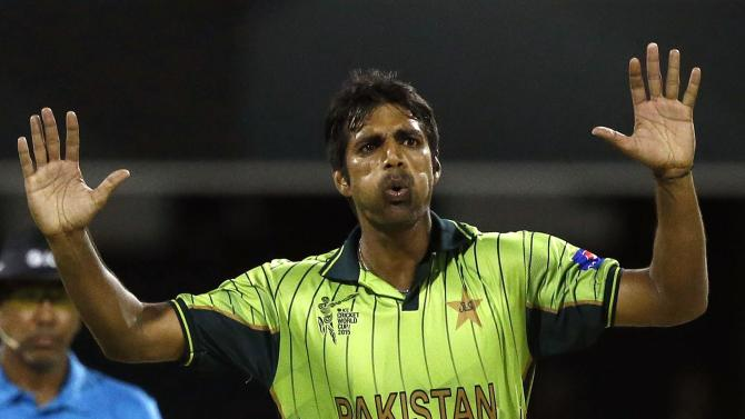 Pakistan's bowler Rahat Ali reacts after nearly taking a wicket during the Cricket World Cup match against Zimbabwe at the GABBA in Brisbane