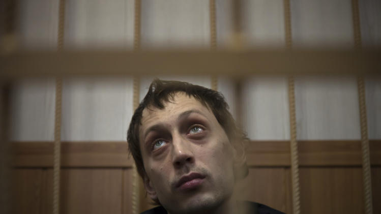 "Bolshoi soloist Pavel Dmitrichenko listens in a courtroom in Moscow, Russia, Thursday, March 7, 2013. The star dancer accused of masterminding the attack on the Bolshoi ballet chief acknowledged Thursday that he gave the go-ahead for the attack, but said he did not order anyone to throw acid on the artistic director's face. Dmitrichenko told a Moscow court that he had complained about ballet chief Sergei Filin to an acquaintance, who offered to ""beat him up."" (AP Photo/Alexander Zemlianichenko)"