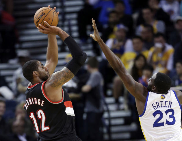 Portland Trail Blazers' LaMarcus Aldridge shoots over Golden State Warriors' Draymond Green (23) during the second half of an NBA preseason basketball game on Thursday, Oct. 24, 2013, in Oakland, Cali