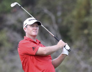 Marcus Fraser of Australia plays a shot on the 16th hole during the second round of the Australian PGA Golf Championship at the Hyatt Regency in Coolum, Australia, Friday, Nov. 25, 2011. (AP Photo/Tertius Pickard)