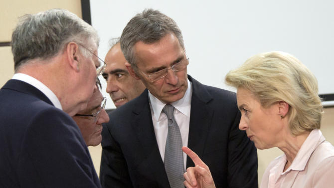 German Defense Minister Ursula von der Leyen, right, speaks with from left, British Secretary of State for Defense Michael Fallon, U.S. Secretary of Defense Ash Carter and NATO Secretary General Jens Stoltenberg during a meeting of the North Atlantic Council at NATO headquarters in Brussels on Wednesday, Feb. 10, 2016. NATO defense ministers convene a two-day meeting to discuss current defense issues and whether the Alliance should take a more direct role in dealing with its gravest migrant crisis since WWII. (AP Photo/Virginia Mayo)