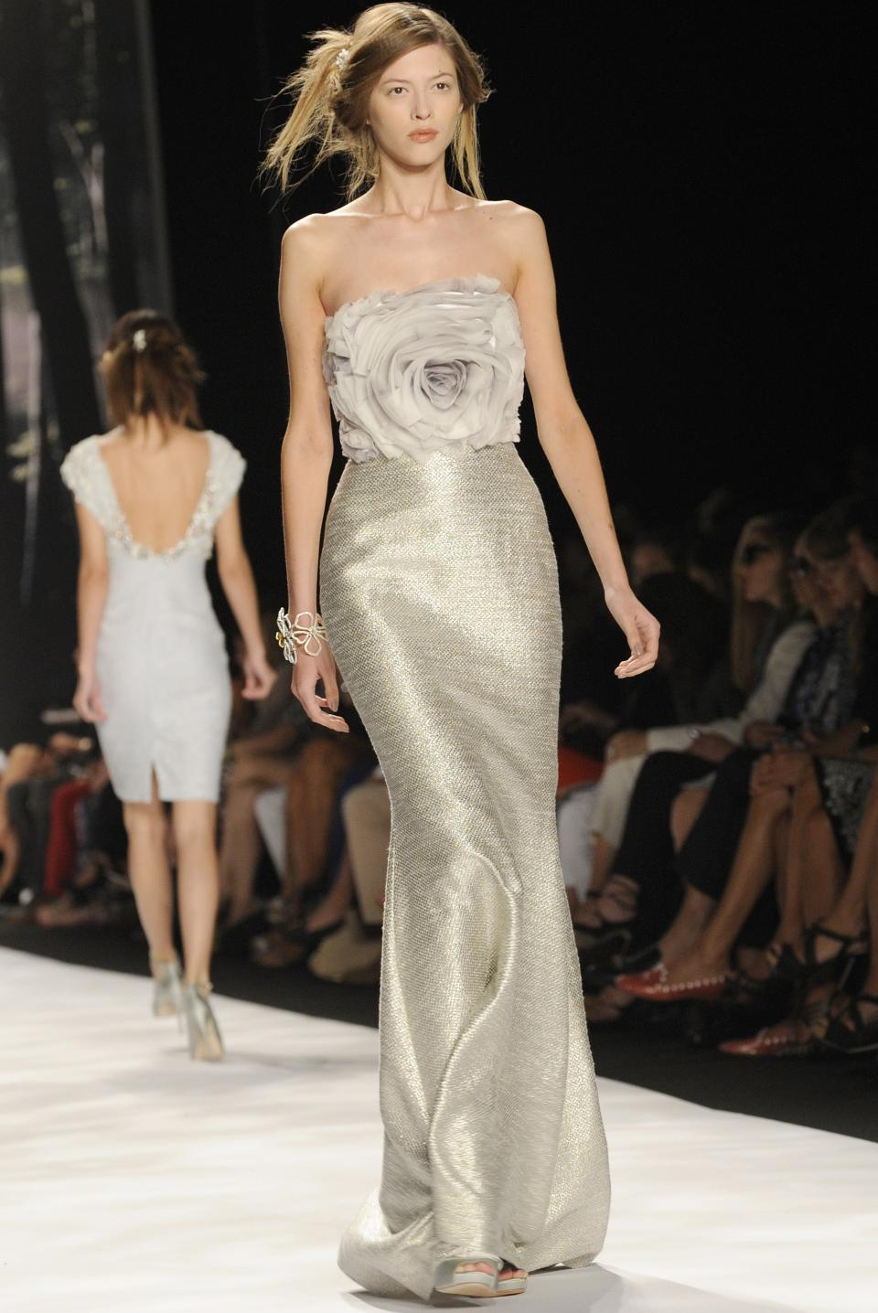 The Badgley Mischka Spring 2013 collection is modeled during Fashion Week, Tuesday, Sept. 11, 2012, in New York. (AP Photo/ Louis Lanzano)