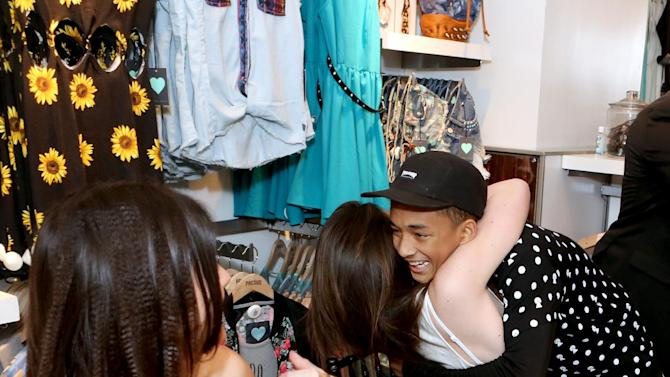 IMAGE DISTRIBUTED FOR PACSUN - From right, Jaden Smith surprises Kylie and Kendall Jenner at the launch of the exclusive Kendall & Kylie summer collection at PacSun in Santa Monica, Calif. on Friday, May 10, 2013. (Photo by Casey Rodgers/Invision for PacSun/AP Images)