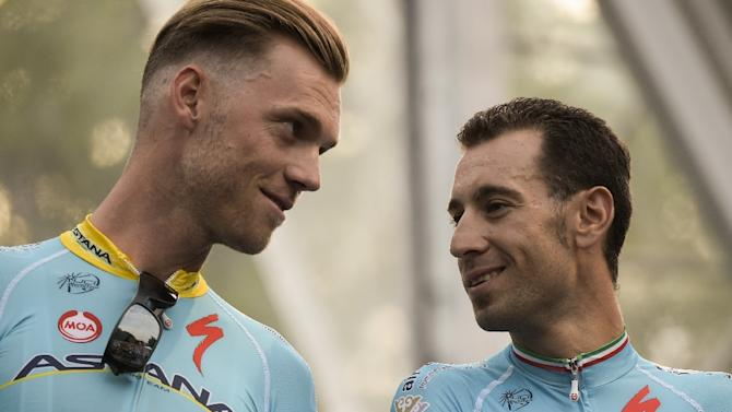 Astana's Lars Boom (L) and Vincenzo Nibali on stage during the team presentation ceremony in Utrecht ahead of the start of the 102nd Tour de France