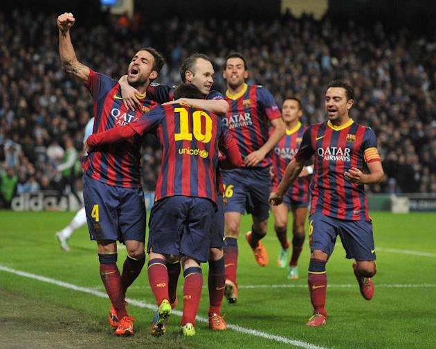 Barcelona's midfielder Cesc Fabregas (L) celebrates with team-mates after Argentinian forward Lionel Messi's (2nd L) goal during the UEFA Champions League match against Manchester City on Febr