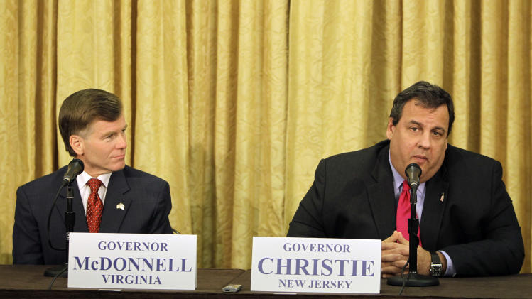 Virginia Gov. Bob McDonnell, left, listens as New Jersey Gov. Chris Chirstie, right, answers during a news conference at the Republican Governors Association annual conference in Orlando, Fla., Wednesday, Nov. 30, 2011. (AP Photo/John Raoux)