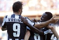 Juventus' Kwadwo Asamoah of Ghana (R) celebrates with teammate Mirko Vulcinic of Montenegro (L) after scoring during the Italian serie A football match Genoa vs Juventus at Luigi Ferraris stadium in Genova. Juve won 3-1