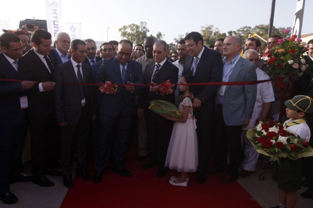Libya's Deputy PM Qadhi and Minister of Economy Abufunas attend a ribbon cutting ceremony in Tripoli