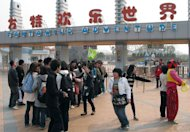 Chinese tourists gather to enter the Fantawild Adventure park in Wuhu, eastern China's Anhui province