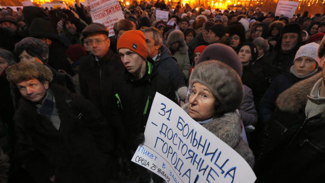 "A demonstrator holds a poster reading ""Hospital No. 31 is a city property"" during a protest against plans to shut down City Hospital No. 31 in St. Petersburg, Russia, Wednesday, Jan. 23, 2013. Some 1,500 thousand people gathered for a rally against plans to shut a clinic specialized in treating children with cancer in order to turn it into a medical center for the nation's top judges. The authorities intention to turn City Hospital No. 31 into a clinic that would exclusively serve judges of Russia's top courts, which are being relocated to St.Petersburg from Moscow, has caused a strong public dismay. On Wednesday, St.Petersburg Governor's office said that the hospital will continue to serve patients as before and there is no plan to change its location or profile.  (AP Photo/Dmitry Lovetsky)"