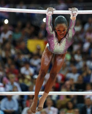 Gabrielle Douglas of the U.S. competes in the women&amp;#39;s gymnastics asymmetric bars final in the North Greenwich Arena during the London 2012 Olympic Games August 6, 2012. (REUTERS/Mike Blake)