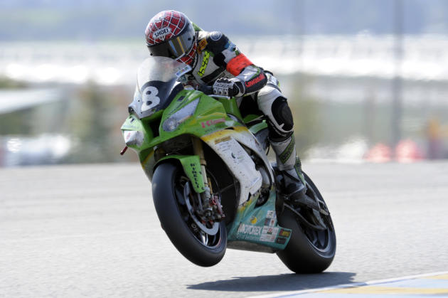 French Jerome Tangre rides his Kawasaki belonging to Bolliger team Switzerland to finish fourth of the 34th edition of Le Mans 24-hour endurance race on September 25, 2011 in the French western city o