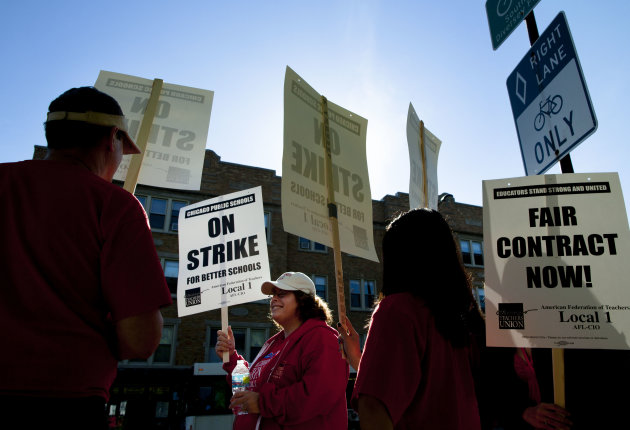 Public school teachers picket outside Amundsen High School in Chicago on the first day of a strike by the Chicago Teachers Union, Monday, Sept. 10, 2012. The school is one of more than 140 schools in