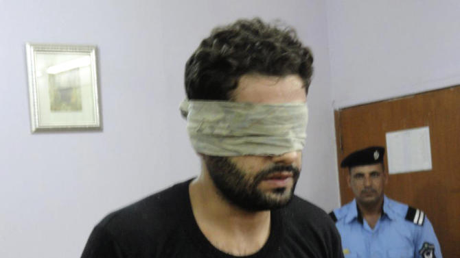 This undated photo released by security officials shows convicted rapist and murderer, Akram al-Mayahi, makes his confessions to raping and killing four-year old Banin Haider, to a judge at the interrogation room in courts complex in Basra 340 miles (550 kilometers) southeast of Baghdad, Iraq. The crimes were particularly brutal, even by the standards of a country where insurgents can still kill dozens in single day: Two young girls kidnapped, repeatedly raped and killed with blows to the head in Iraq's southern Basra province. (AP Photo)