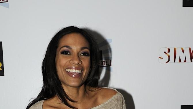 Rosario Dawson arrives at the EA SimCity Learn. Build. Create. Inauguration After-Party, Tuesday, Jan. 22, 2013, in Washington. (Photo by Nick Wass/Invision for EA/AP Images)